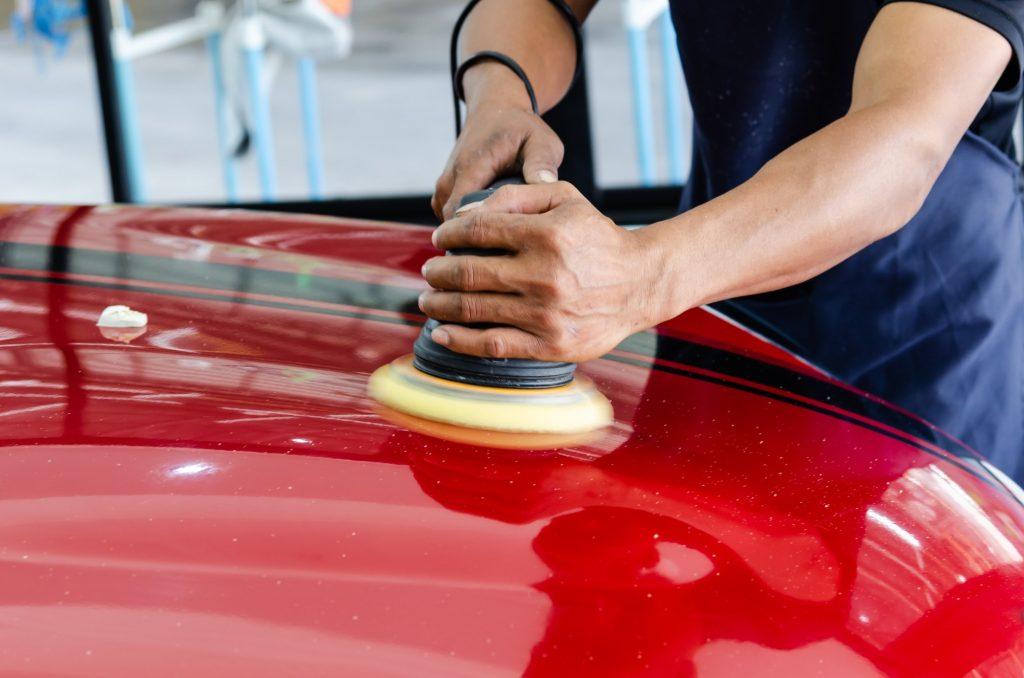 Car detailing.Man hand holding and polish the car.